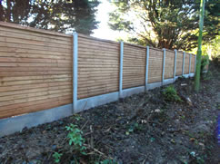 Fence using concrete posts and gravel boards
